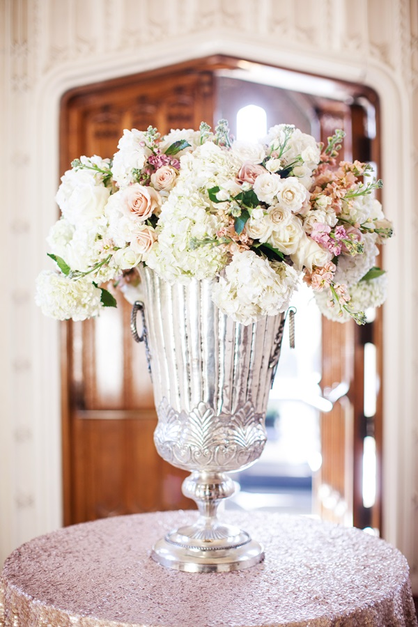 Hydrangeas and roses in large mercury glass vase