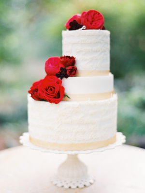 Off Center Tiered Cake With Red Roses