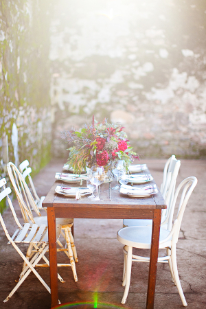 Outdoor Table and Chairs by Stone Wall