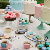 Pastel Colored Cakes and Macaroons Dessert Table