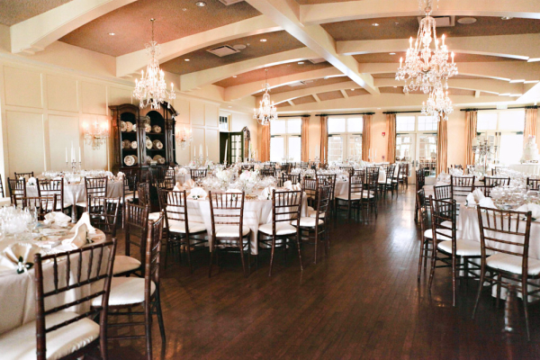 Reception Venue With Chandeliers and Wood Floors