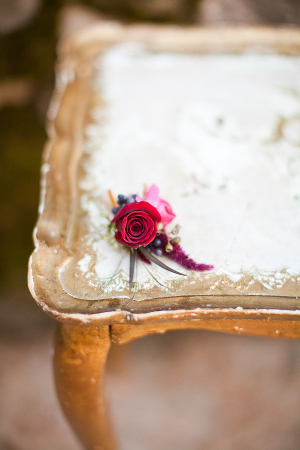 Rose Boutonniere on Vintage Gold Table