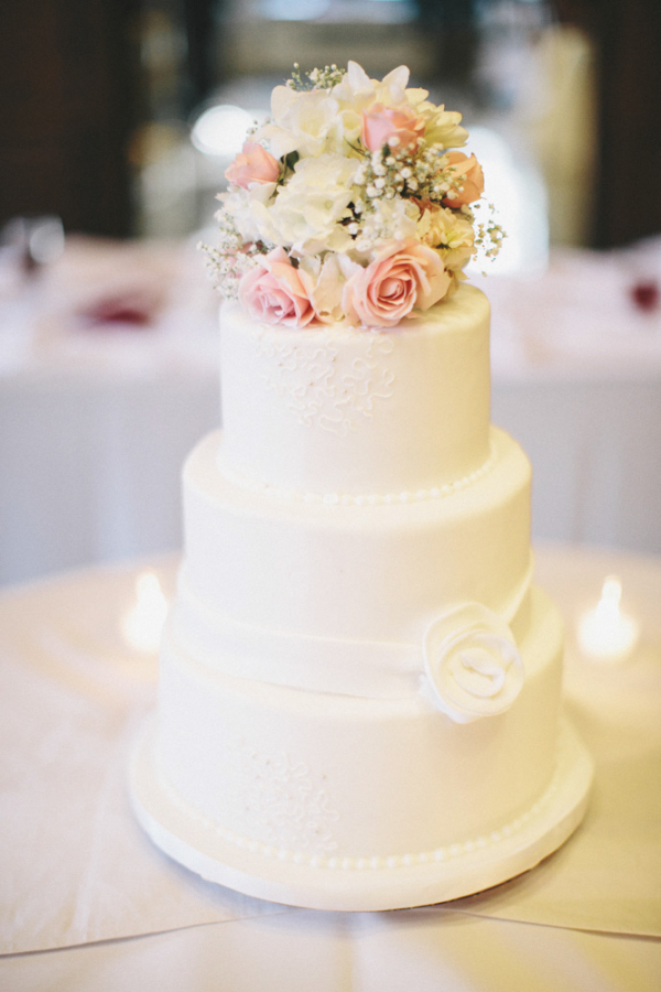 Simple White Wedding Cake With Flower Bouquet Topper