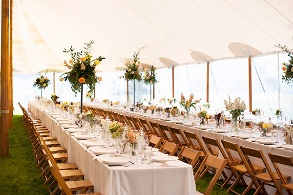 Tent Reception With Long Tables And Wooden Chairs