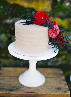 Wedding Cake With Combed Icing and Flowers