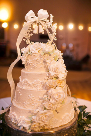 Wedding Cake With Sugar Flowers and Bell Topper