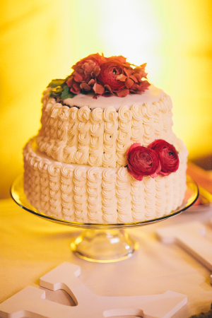 Wedding Cake with Red Flowers
