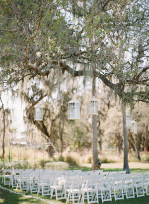 White Lanterns Hanging From Trees Outdoor Ceremony Decor
