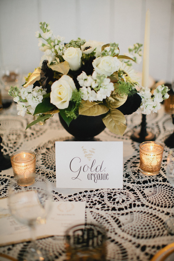 White and Gold Flowers in Black Vase