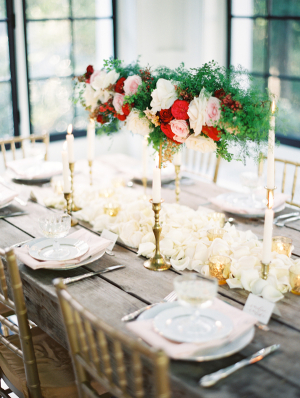 Wood Table With Rose and Fern Garland and Gold Candlesticks