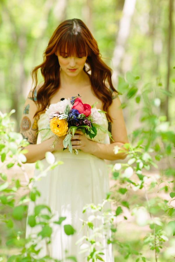 Bride Standing in Woods