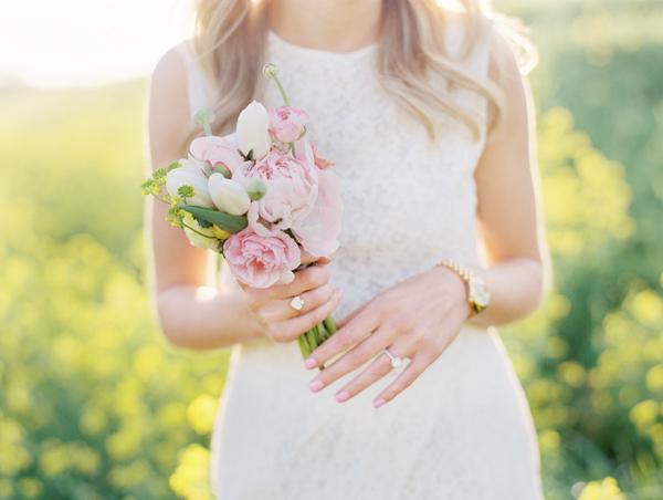 Bride in White Dress Holding Pastel Bouquet