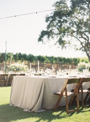 Gray Linen Table Linens and Rustic Wood Chairs