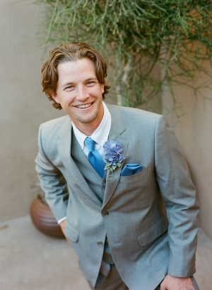 Groom in Gray Suit With Blue Tie and Hydrangea Boutonniere