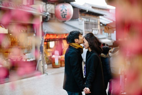 Man Kissing Fiance on Japanese Street