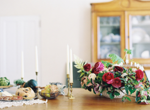 Vintage Tablescape With Green and Red Floral Centerpiece