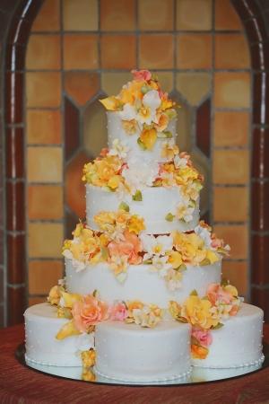 Wedding Cake With Yellow and Orange Flowers