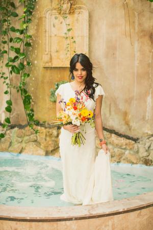 Bride Standing in Fountain