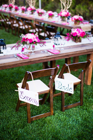 Bride and Groom Signs on Wooden Chairs