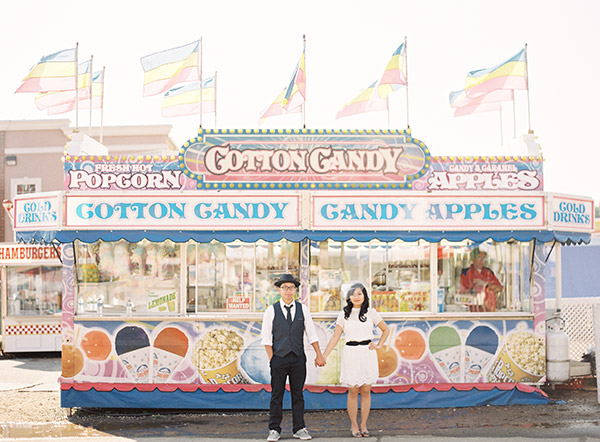 Couple Holding Hands at Cotton Candy Booth