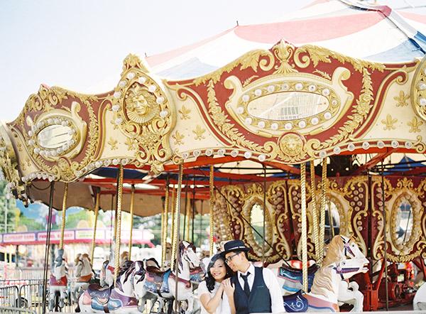 Couple Riding Carousel