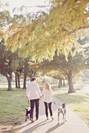 Engaged Couple Walking With Dogs