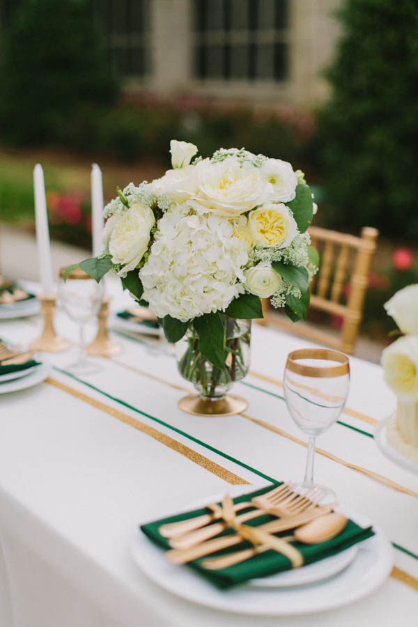 Green and Gold Table Linens With White Flowers