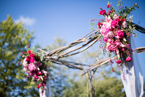 Rustic Branch Ceremony Altar With Pink Flowers