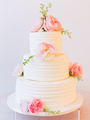 Wedding Cake With Combed Icing and Fresh Flowers