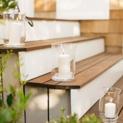 White Candles on Wooden Steps