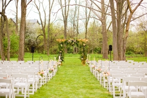 Wooden Ceremony Pergola With Floral Garland