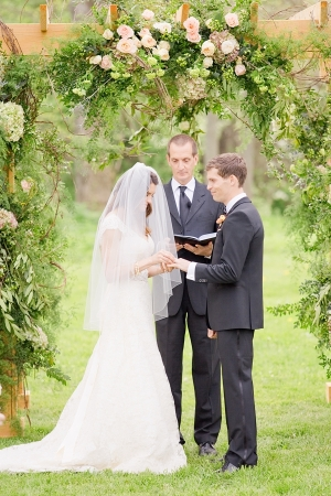 Wooden Ceremony Pergola With Roses and Greenery