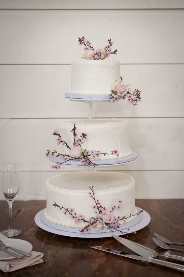 classic wedding cake with cherry blossom branches