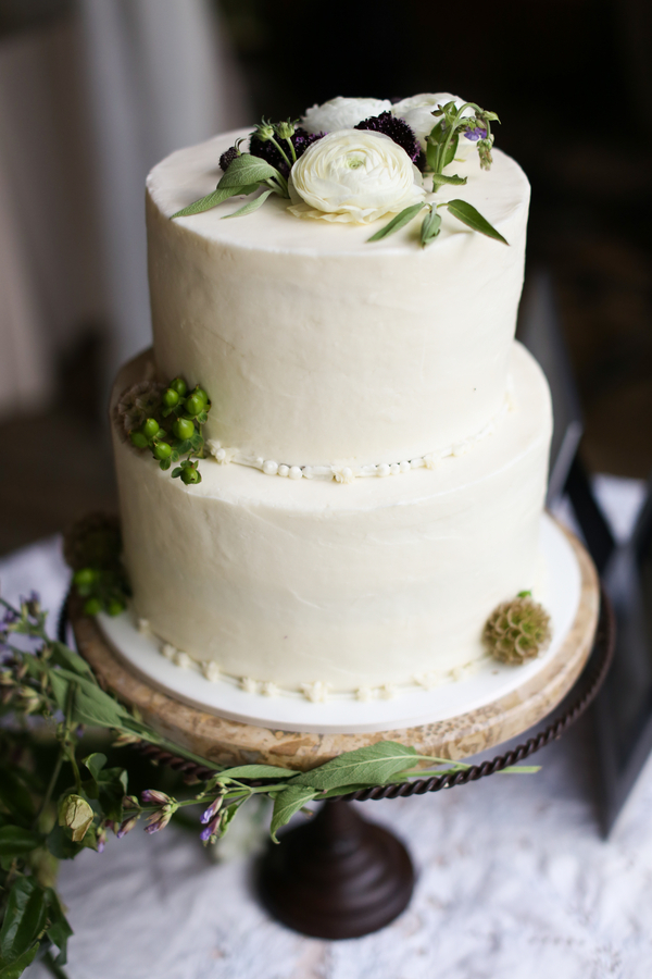 classic wedding cake with greenery garnish