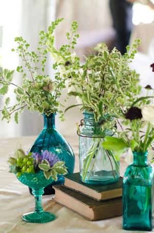 Greenery in Blue Glass Bottles