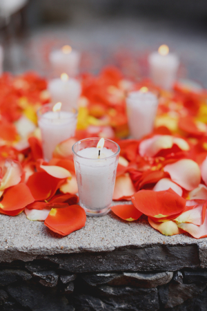 Orange Rose Petals and Candles Ceremony Decor