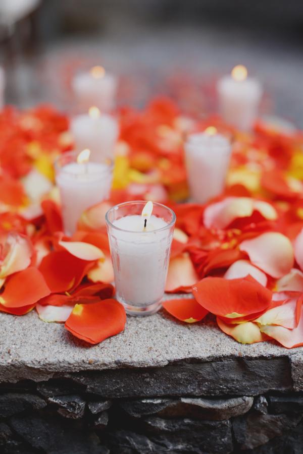 orange rose petals and candles ceremony decor elizabeth anne