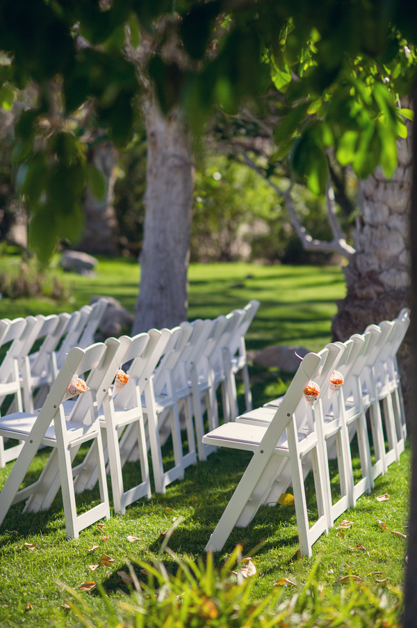 White Folding Chairs At Outdoor Wedding Ceremony