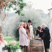 Bride and Bridesmaid Hugging