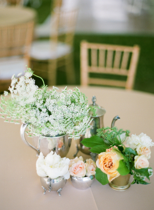 Clustered Flowers in Silver Cups