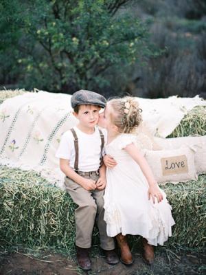 Flower Girl and Ring Bearer on Hay Bales