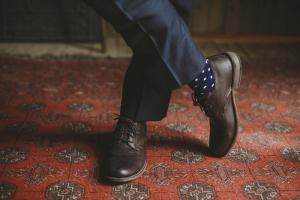 Groom in Navy Polka Dot Socks