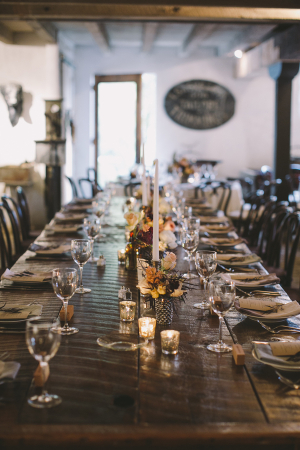 Long Wooden Table With Candles at Reception