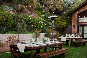 Outdoor Reception With Warm Wood Tables and Cream Decor