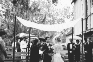 Outdoor Wedding Ceremony Beneath Arbor