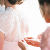 Sheer Jacket With Buttons on Wedding Gown