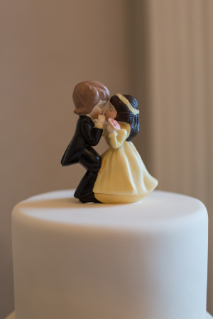 Bride and Groom Kissing Cake Topper