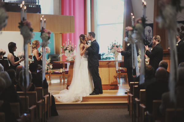 Bride and Groom Kissing at Church Ceremony