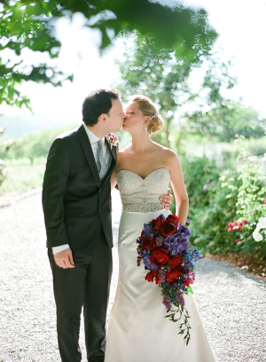 Bride and Groom Kissing in Vineyard From Bret Cole Photography