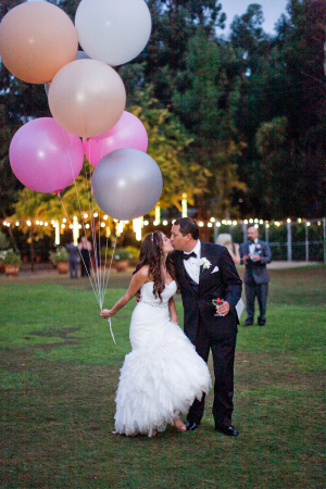 Bride and Groom With Oversize Balloons